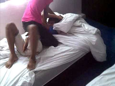 Thai girl pins down her younger brother